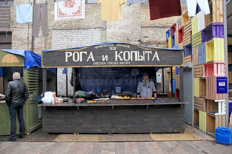 Unidentified people cook and trades traditional Odessa dishes on food stall in Street Food Festival in Kiev, Ukraine. royalty free stock images