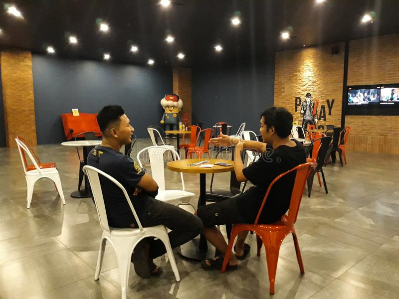 Unidentified people. Couple of asian male talking business in the lobby CGV cinema royalty free stock photography