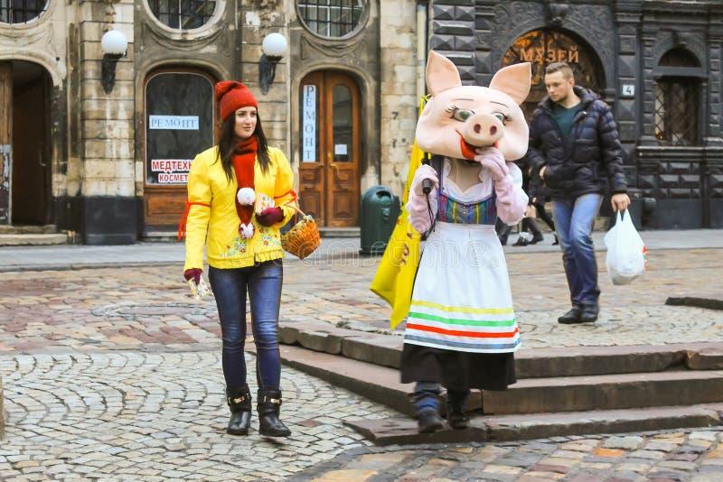 Unidentified people in historic city center Rynok Square in Lviv stock photo