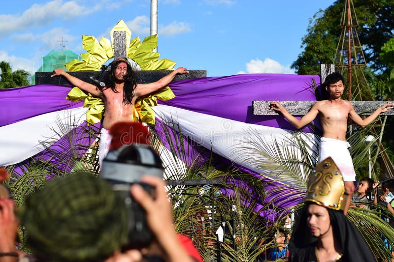 Unidentified people playing role of Jesus Christ crucified, publicly. San Pablo City, Laguna, Philippines - April 14, 2017: Unidentified people playing role stock image
