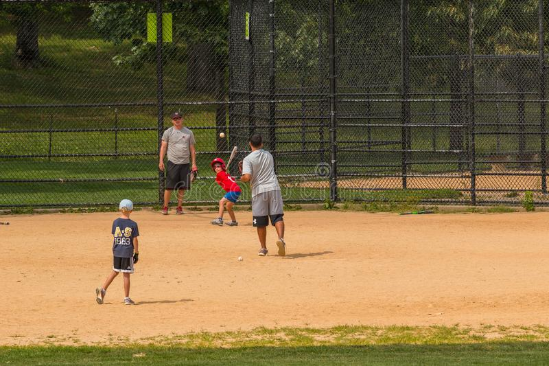 Unidentified people plays amateur baseball in Central Park. New York, NYC , USA - August 28, 2017: Unidentified people plays amateur baseball in Central Park stock images