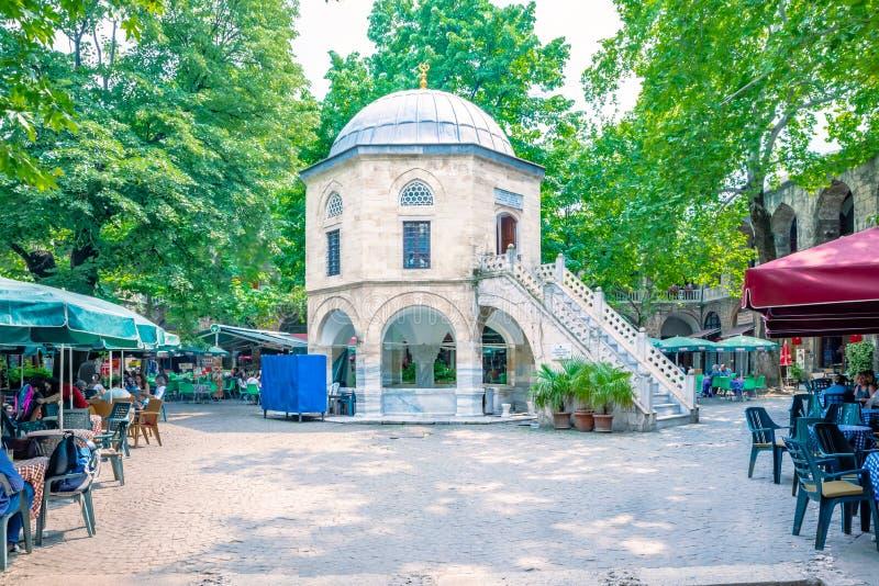View of Koza Han(Silk Bazaar) in Bursa, Turkey. Unidentified people rest at cafes in historical Koza Han(Silk Bazaar) in Bursa,Turkey.20 May 2018 stock images