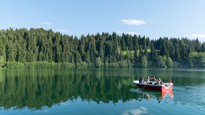 Unidentified people rowing in a boat in Savsat Karagol Nature Park in Blacksea region, Artvin, Turkey royalty free stock photos