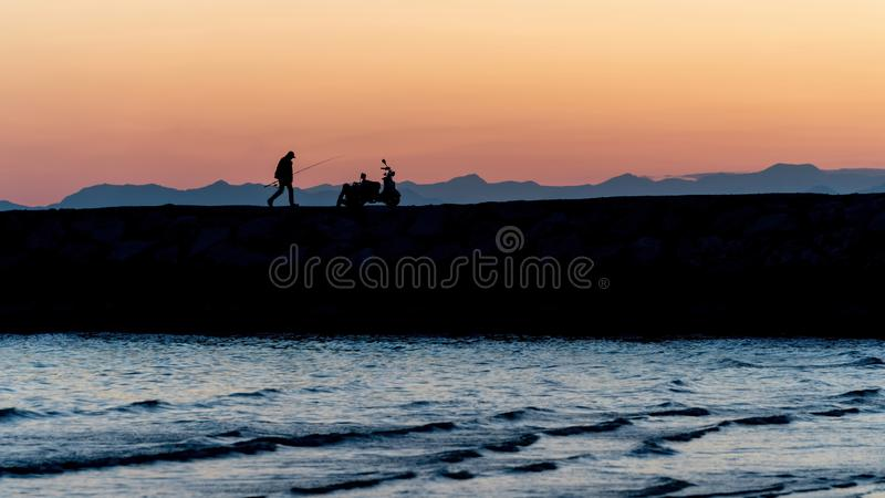 Unidentified people silhouette walking during sunset in Side, Antalya, Turkey royalty free stock photography
