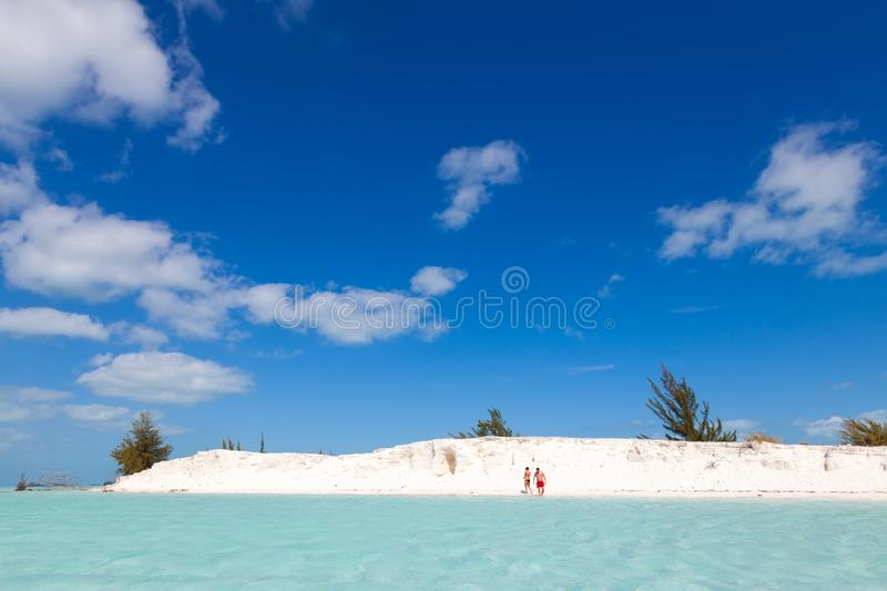 Unidentified people on the snow-white beach and the azure Caribbean Sea. Pair men and women. Cayo largo island. Cuba. stock image