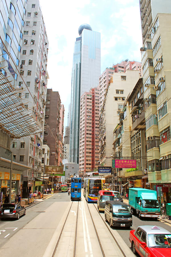 Unidentified people are walking on the street in Hong Kong stock images