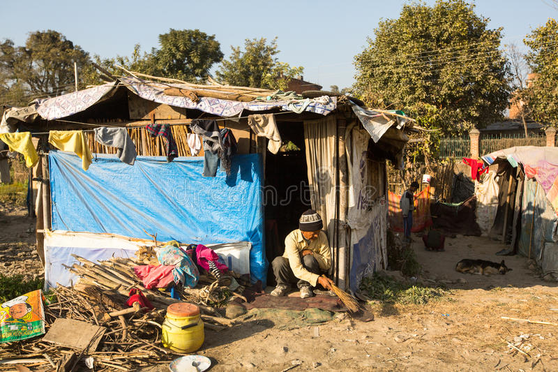 Unidentified poor people near their houses at slums in Tripureshwor district, Kathmandu. KATHMANDU, NEPAL - DEC 16, 2013: Unidentified poor people near their royalty free stock images