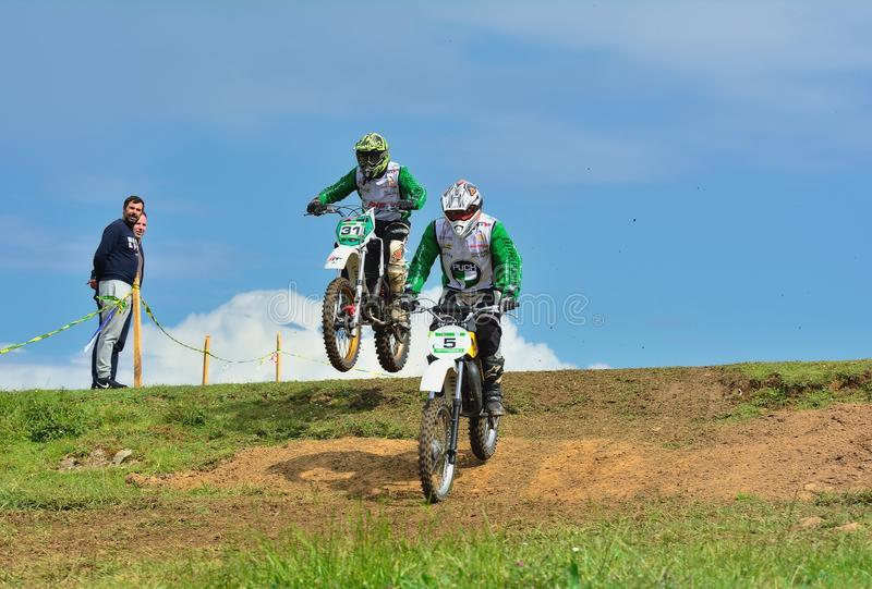 Unidentified racers rides a classic motorcycle. stock images