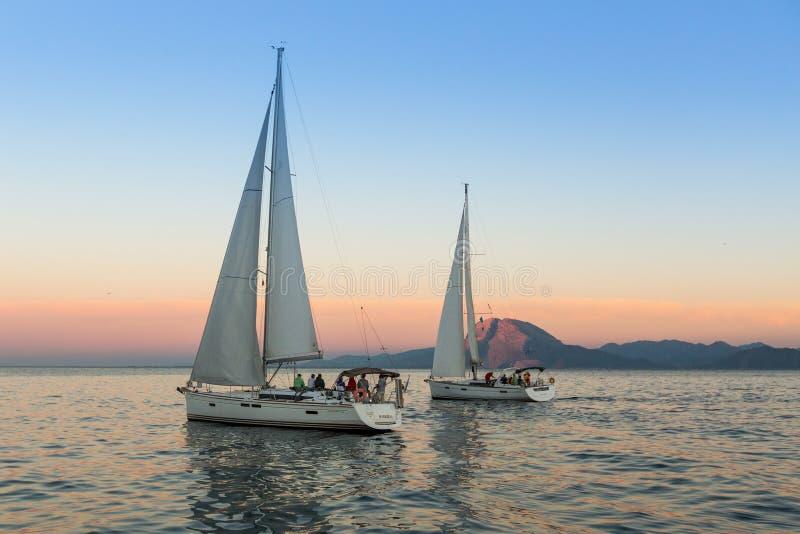 Unidentified sailboats participate in sailing regatta stock images
