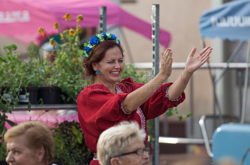 Unidentified spectator applaud and smiling. PODOLSK, RUSSIA - SEPTEMBER 9, 2018: Unidentified spectator applaud on a concert. Day of the Moscow city. Event in royalty free stock photo