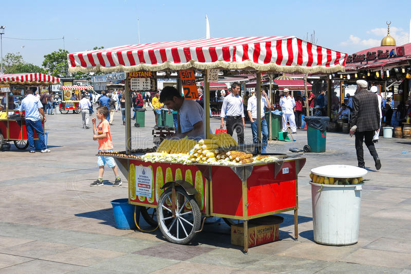 Unidentified street vendor sells corn on a street. STANBUL, TURKEY - MAY 20: Unidentified street vendor sells corn on a street on May 20, 2016, Istanbul, Turkey stock images