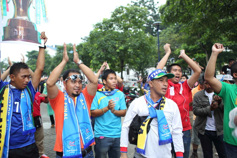 Unidentified Thai football fans in action royalty free stock photos