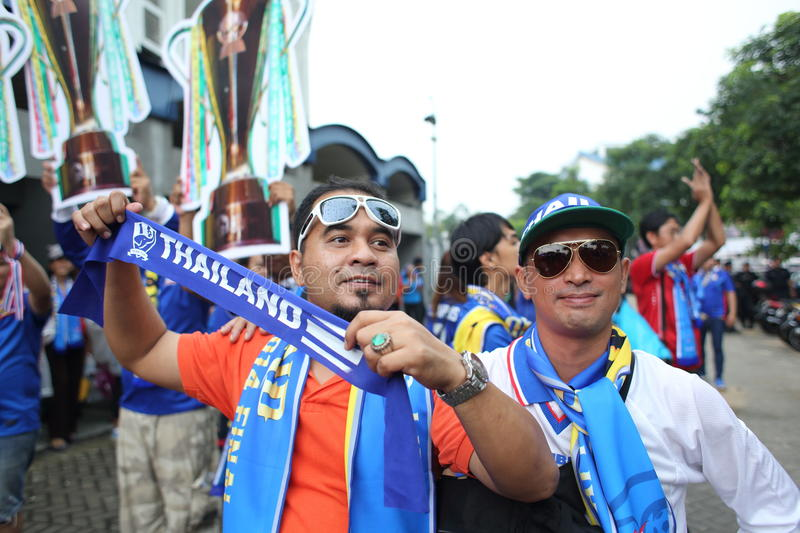 Unidentified Thai football fans in action royalty free stock image
