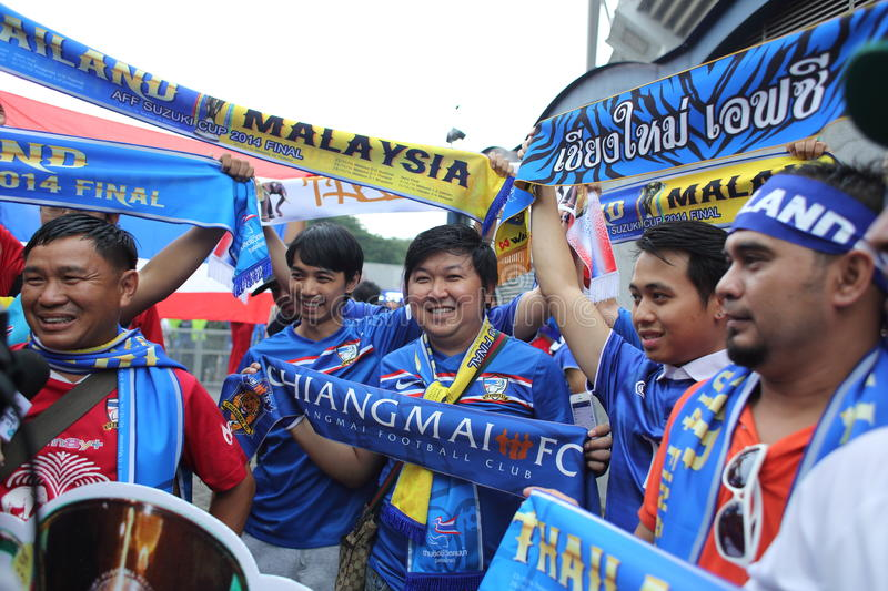 Unidentified Thai football fans in action stock photos