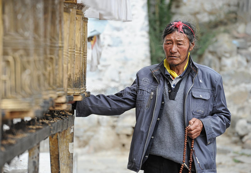 Unidentified Tibetan pilgrim circles the Potala palace royalty free stock photos