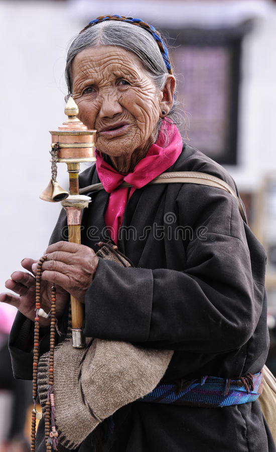 Unidentified Tibetan pilgrim circles the Potala palace stock photos