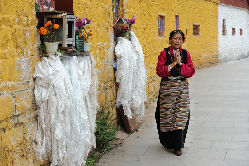 Unidentified Tibetan pilgrim circles the Potala palace royalty free stock image