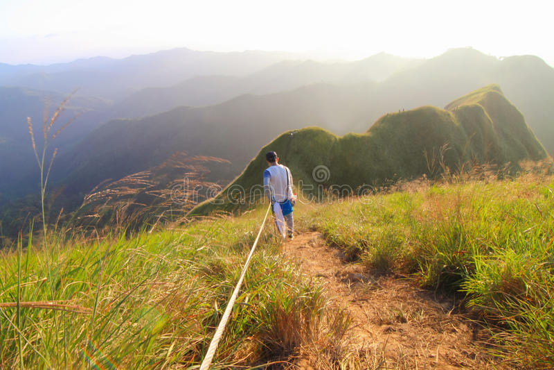An Unidentified Tourism climbing the KhaoChangPouk mountain stock photos