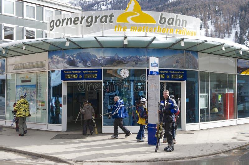 Unidentified tourists enter Gornergratbahn train station in Zermatt, Switzerland. royalty free stock photography