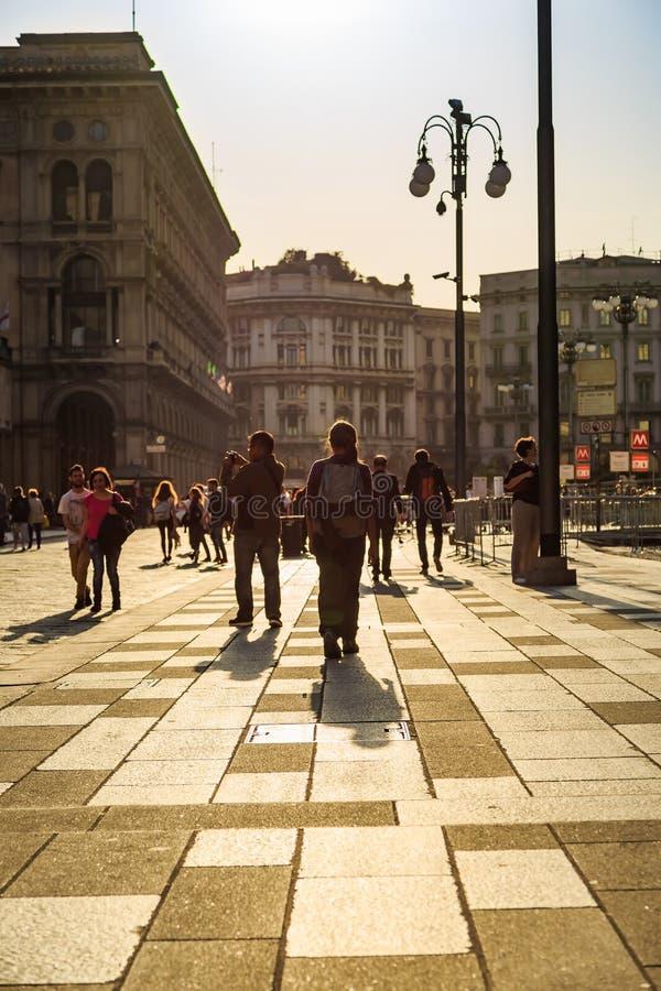 Unidentified tourists walk around Duomo royalty free stock photography