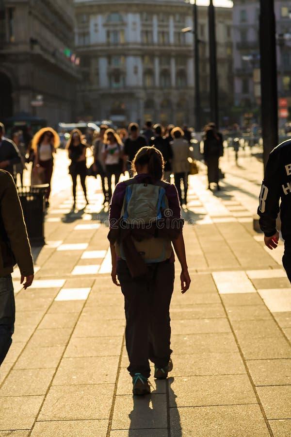 Unidentified tourists walk around Duomo stock images