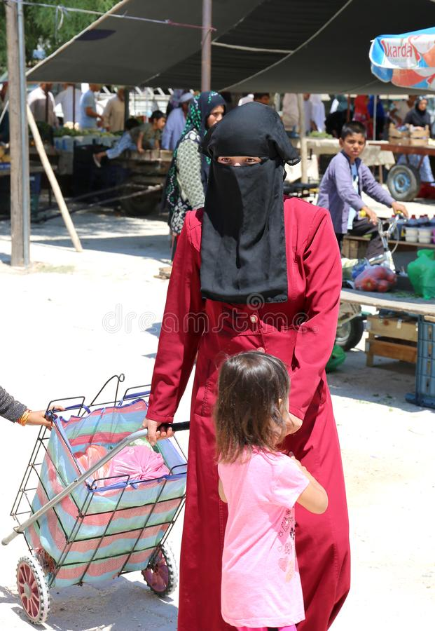 Unidentified Woman with Burka shopping at the farmers market royalty free stock photos
