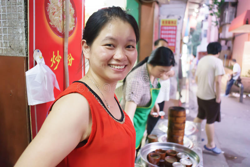 Unidentified woman sell food at market. SHENZHEN, CHINA-MAY 12: Unidentified woman sell food at market on May 12, 2013 in Shenzhen, China. ShenZhen is regarded royalty free stock photo