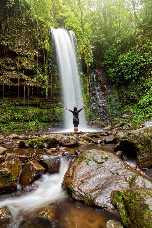 Unidentified Woman Standing at Mahua Waterfall stock photography
