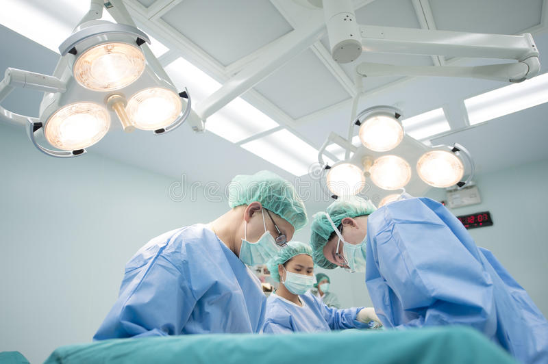 An unidentified woman are undergoing cesarean delivery by a medical team royalty free stock photography