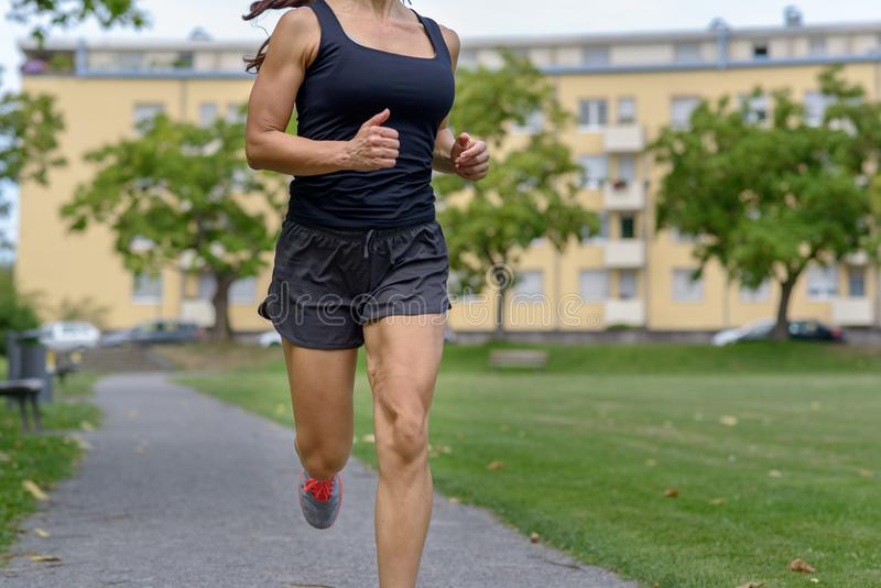 Unidentified woman wearing tank top and shorts royalty free stock photo