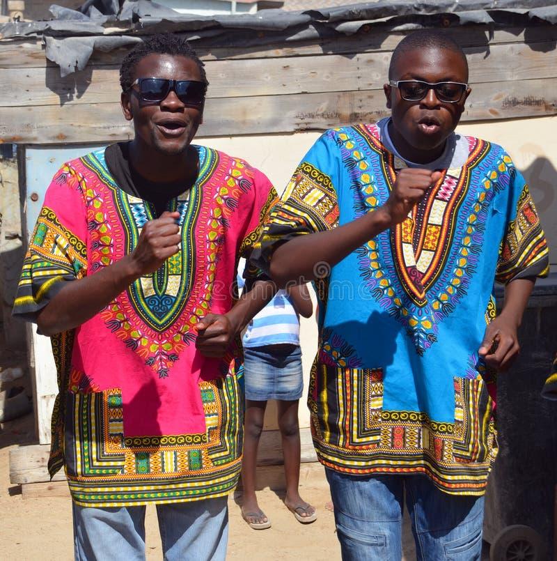 Unidentified young men street singer in Mondesa slum. SWAKOPMUND, NAMIBIA OCTOBER 09, 2014: Unidentified young men street singer in Mondesa slum of Swakopmund on royalty free stock photo