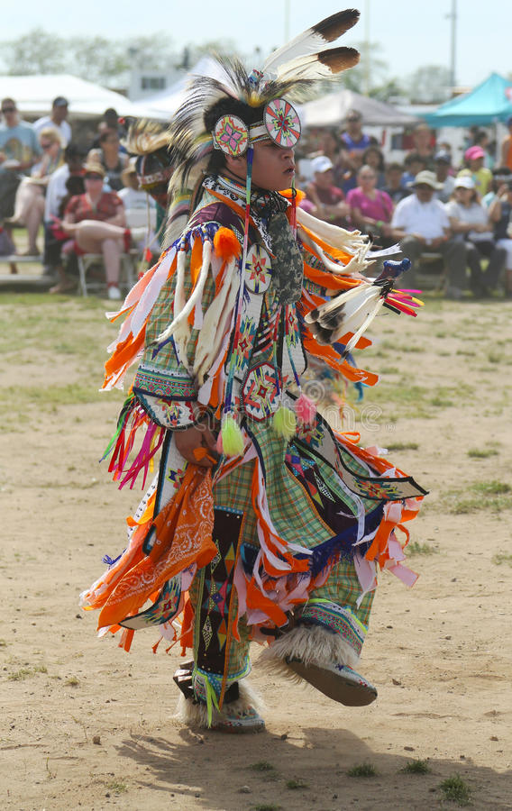 Unidentified young Native American dancer at the NYC Pow Wow. BROOKLYN, NEW YORK - JUNE 2: Unidentified young Native American dancer at the NYC Pow Wow in royalty free stock images