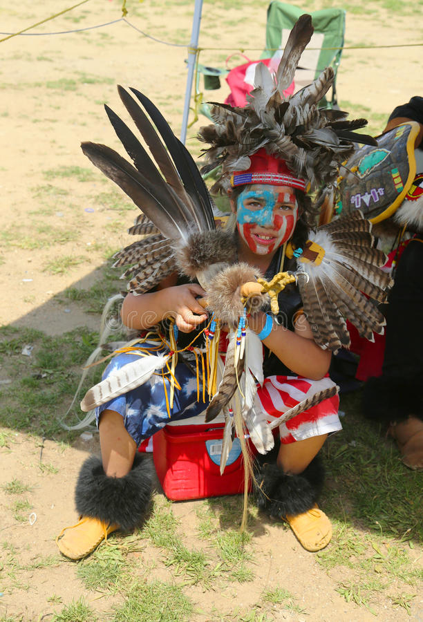 Unidentified young Native American dancer at the NYC Pow Wow. BROOKLYN, NEW YORK - JUNE 2: Unidentified young Native American dancer at the NYC Pow Wow in royalty free stock photos