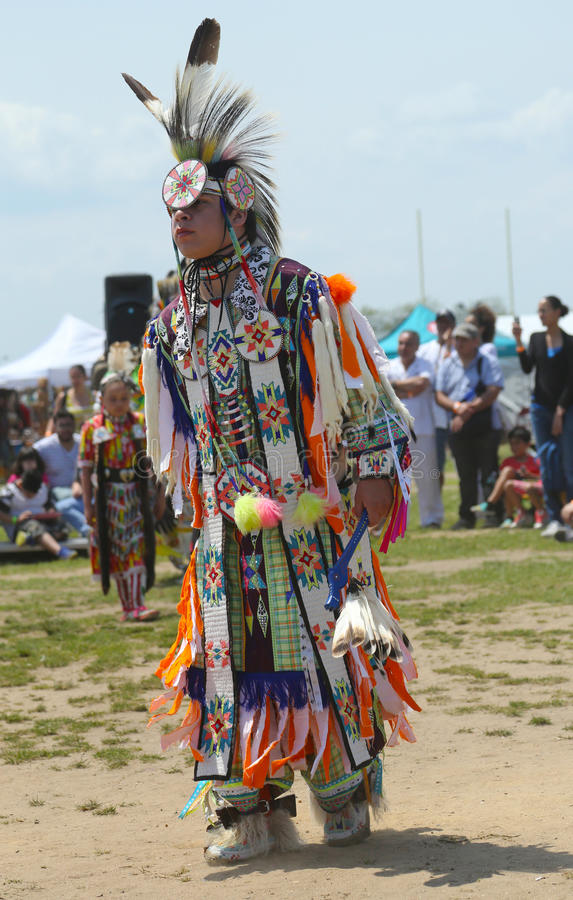 Unidentified young Native American dancer at the NYC Pow Wow in Brooklyn. BROOKLYN, NEW YORK - JUNE 2 Unidentified young Native American dancer at the NYC Pow royalty free stock photo
