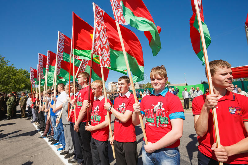 Unidentified Youth From Patriotic Party Brsm Holds. GOMEL, BELARUS - MAY 9, 2014: Unidentified youth from patriotic party BRSM holds flags on the celebration of royalty free stock photography