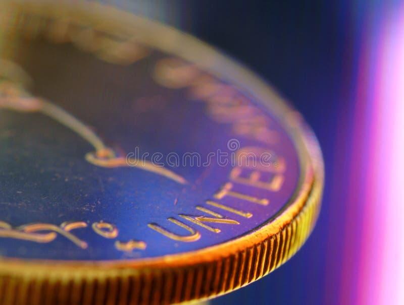Unido, próximo acima de uma moeda