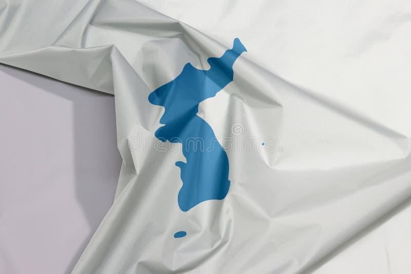 Unifikacyjna Korea tkaniny flaga krepa i zagniecenie z biel przestrzenią zdjęcie stock