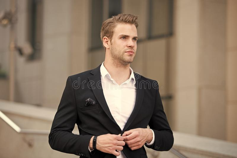 Uniform business environments decorum professionalism woven culture organization. Man formal suit businessman well. Groomed urban background. Professional stock photo