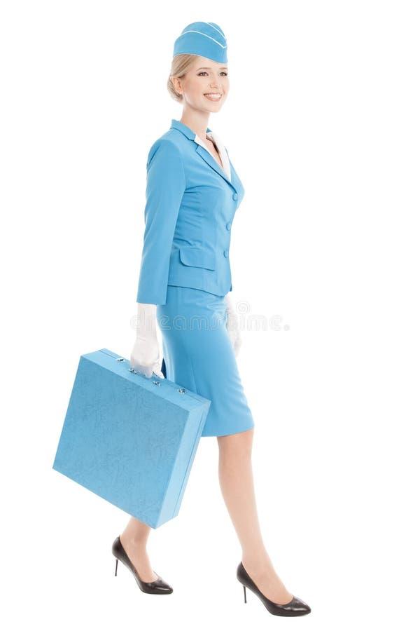 Uniforme et valise avec du charme de Dressed In Blue d'hôtesse sur le blanc photographie stock