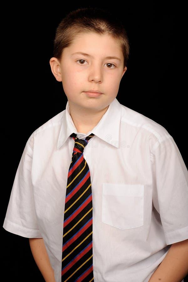 uniforme intelligent d'école de garçon images stock