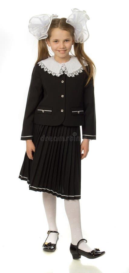 uniforme scolaire de fille de cerise photographie stock libre de droits