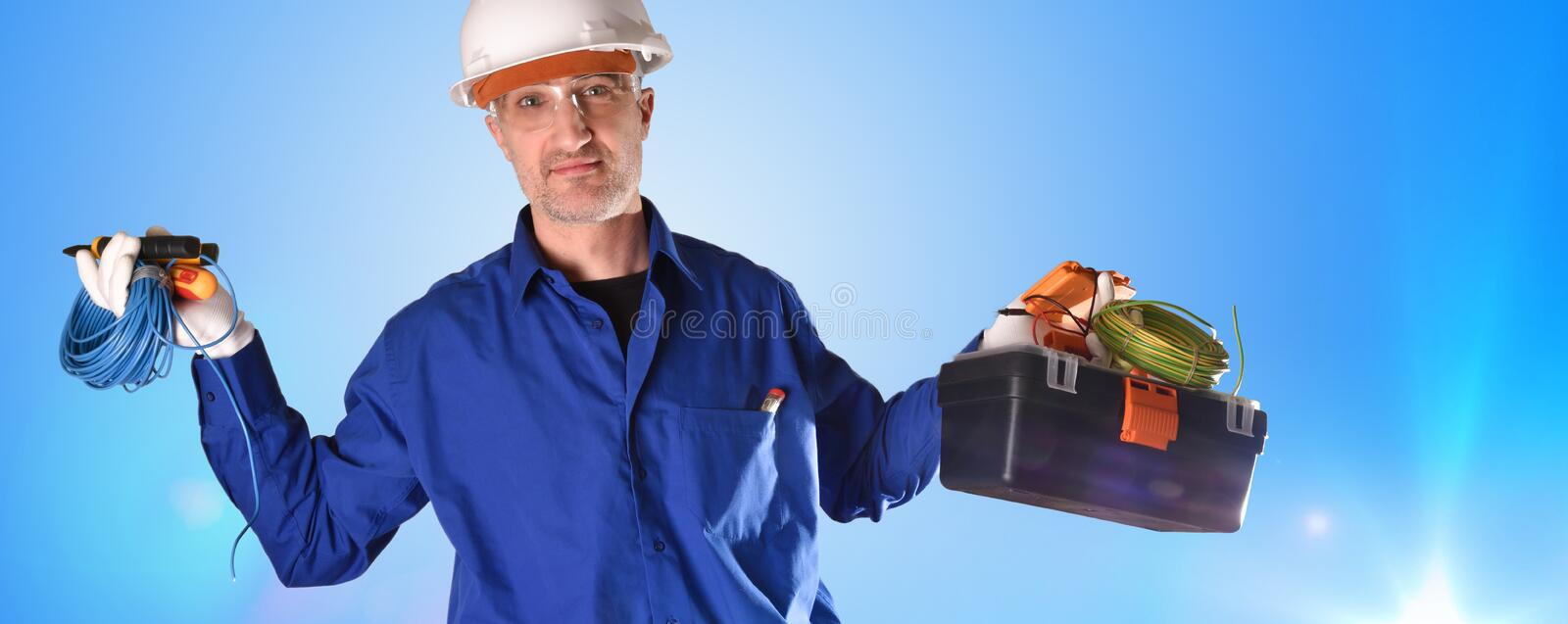 Uniformed electrician with safety protections and work tools with lights royalty free stock image