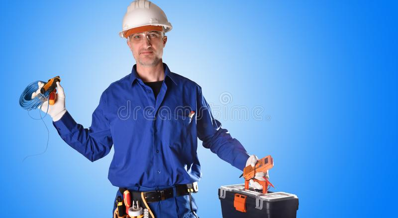 Uniformed electrician with safety protections and work tools royalty free stock photo