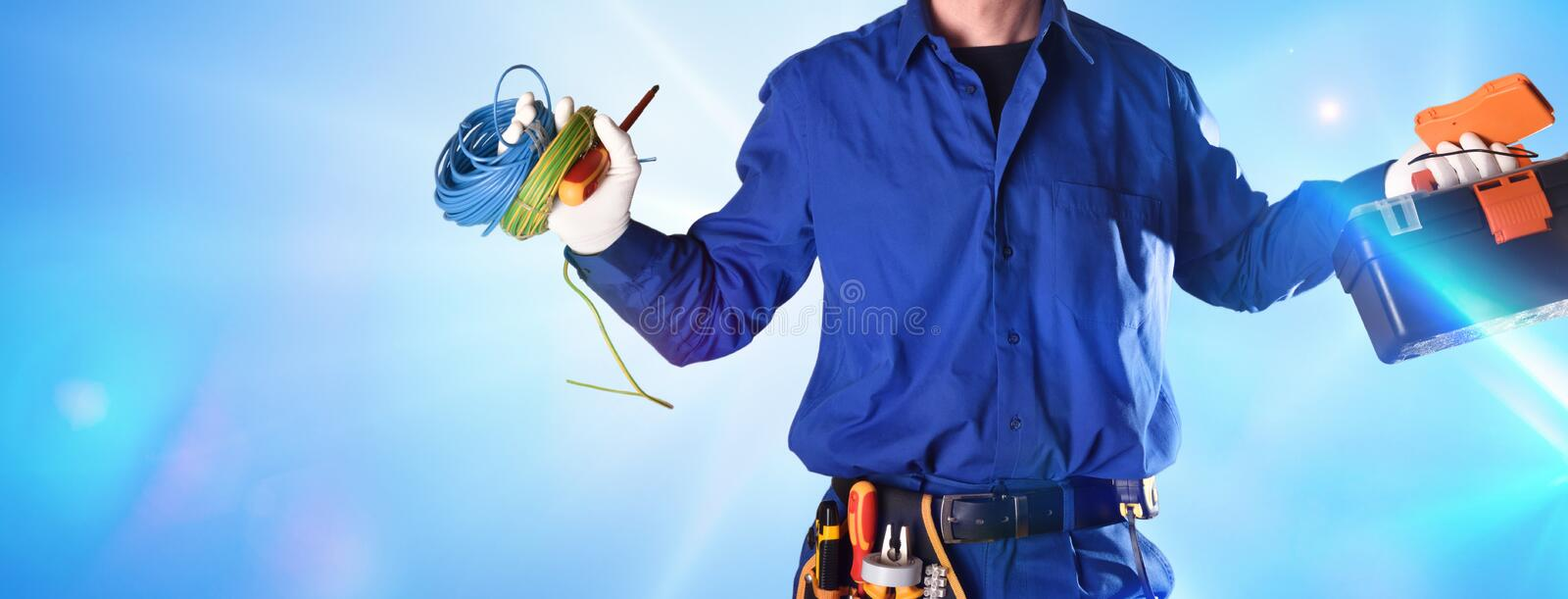 Uniformed electrician with tools and equipment with effect of lights stock photo