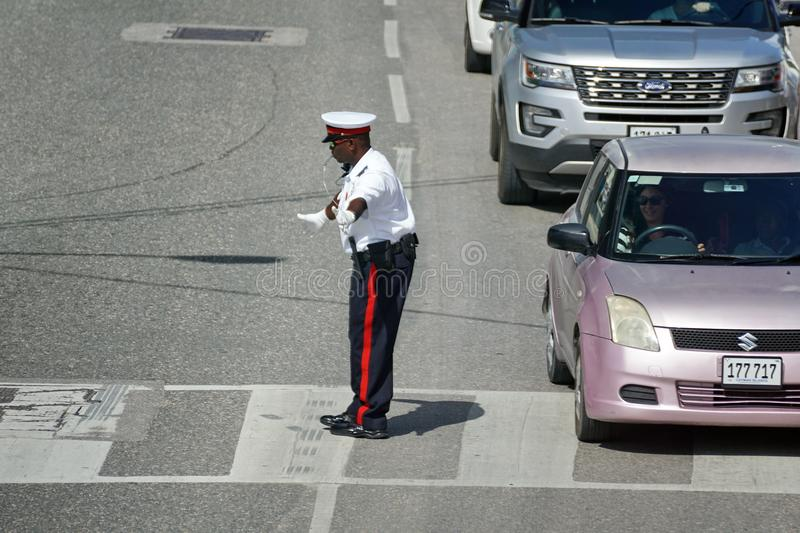 Uniformed police officer on Grand Cayman stock photos