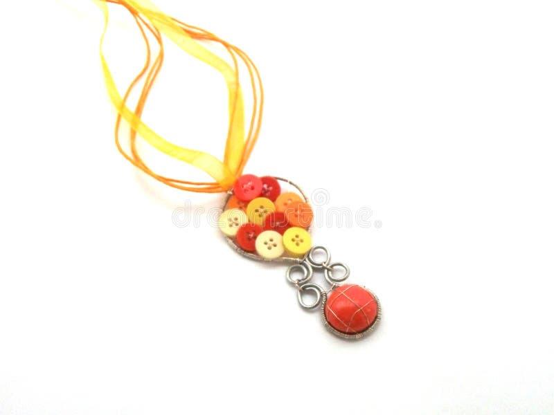 Unikalna handmade biżuteria robić srebra druciany i pomarańczowy szkło fotografia stock