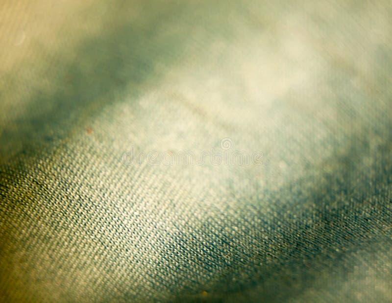 Unikalny błękitnej i żółtej sukiennej tekstury makro- up zakończenie obraz royalty free