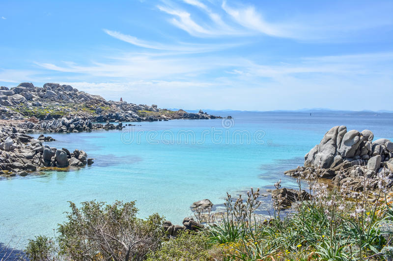 Uninhabited island Lavezzi near Bonifacio, Corsica, France. Beautiful blue sea in the summer. Azure beach with rocks and clear water royalty free stock images