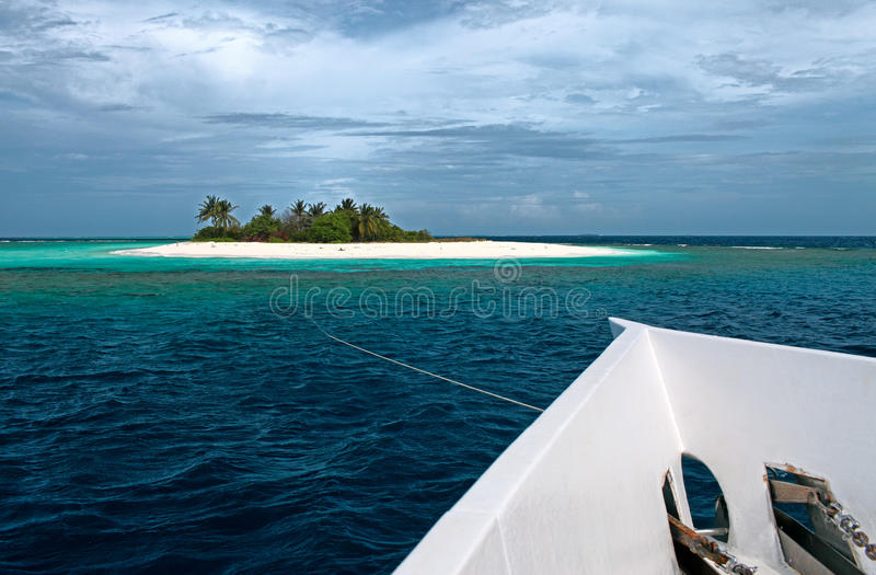Uninhabited island and yacht stock photography