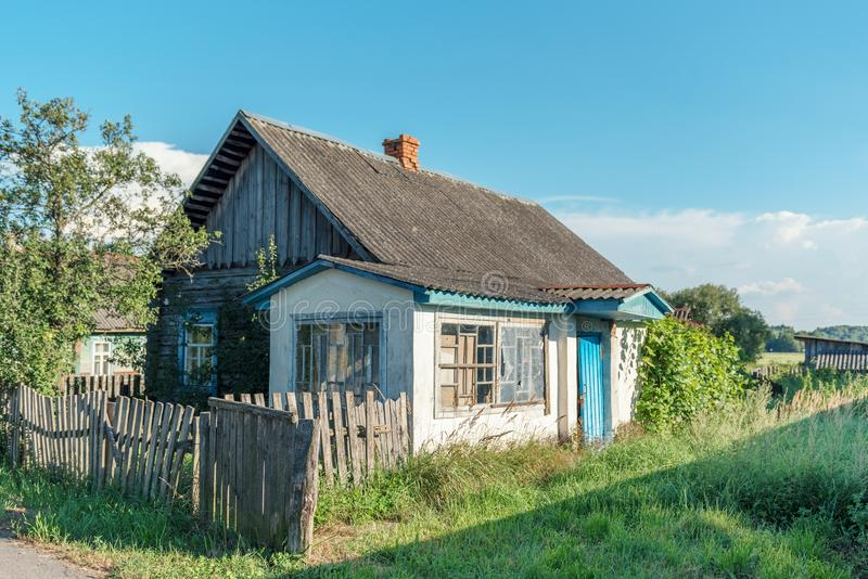 Uninhabited ruined abandoned ancient village house in the countryside royalty free stock photography